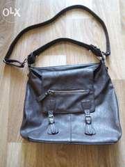 шкіряна сумка коричневого кольору