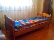 Деревяная детская (подростовая) кровать с матрасом.